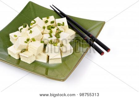 Tofu Cubes With Spring Onion And Chopsticks