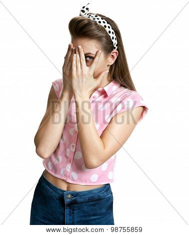 Surprised Girl Peeking Through Hands Covering Face