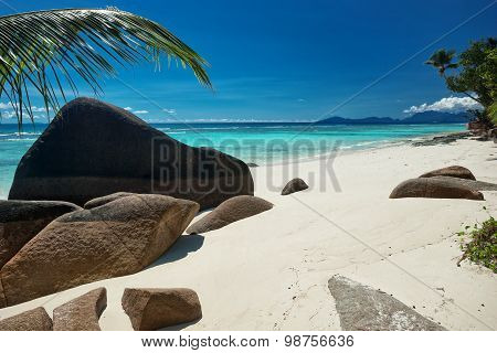 Beautifully Shaped Granite Boulders Laying On Sandy Beach