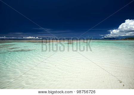 Beautiful Tropical Crystal Clear Sea And Blue Sky With Clouds