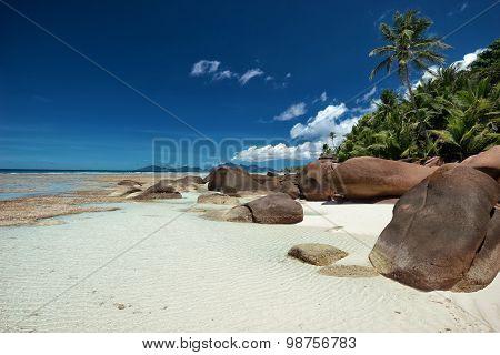Large Granite Boulders On The White Sandy Beach