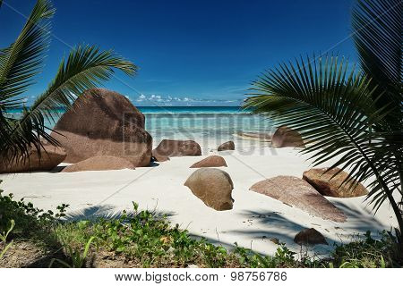 Big Granite Boulders On The White Sandy Beach