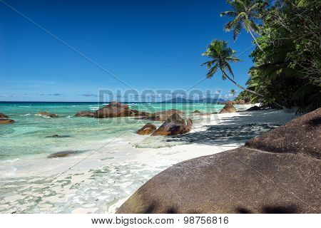 Deep Blue Sky And Beautiful Beach With Large Stones