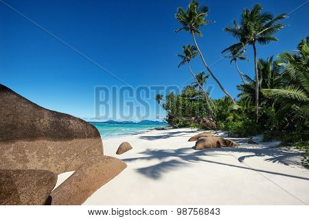 Deep Blue Sky And Beautiful Beach With Huge Stones