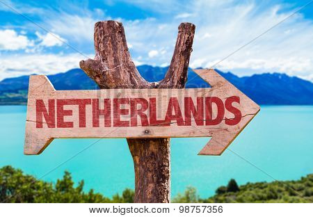 Netherlands wooden sign with river on background