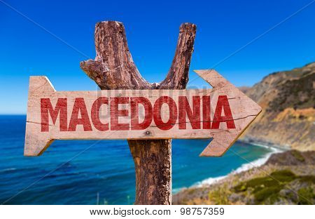 Macedonia wooden sign with coast background