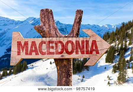 Macedonia wooden sign with winter background
