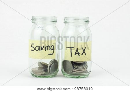 Coins In Glass Money Jar With Tax And Savings Label, Financial Concept.