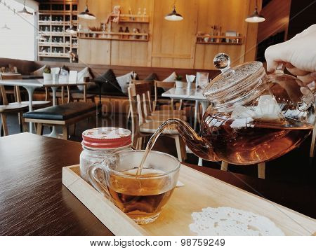 Tea Time, Tea Pouring Into A Clear Glass
