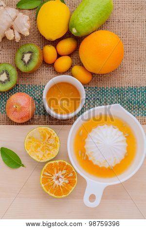 Freshly Orange Juice With Orange Slice, Ginger , Passion Fruit ,honey ,kiwi Set Up On Wooden Table .