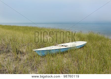 Small Sailboat Sitting In Dune Grass Next To Lake Huron