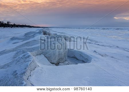 Natural Ice Sculptures On A Frozen Lake Huron At Sunset