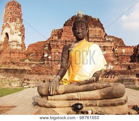 ancient Buddha in yellow robe