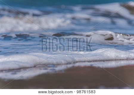 Waves On The Sandy Beach With Bubbles