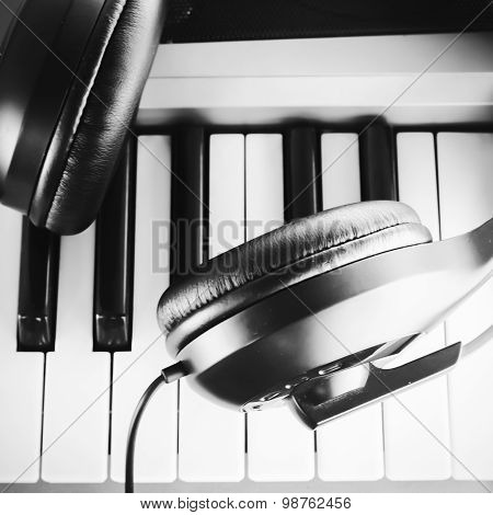 Headphones On Electric Piano Keyboard Black And White Color Tone Style