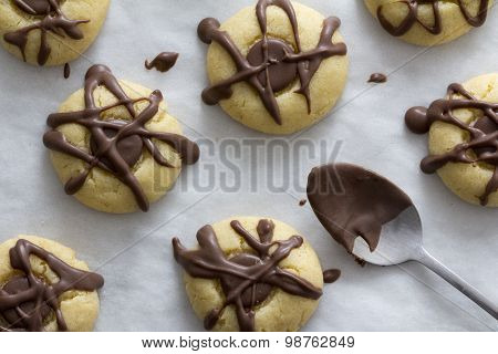 Maple Cookies with Chocolate on Baking Paper