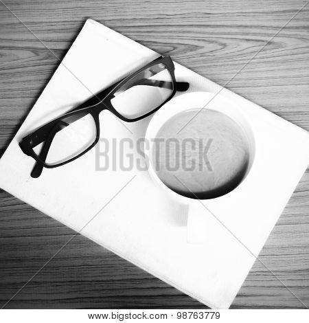 Coffee Cup And Notebook With Glasses Black And White Color Tone Style