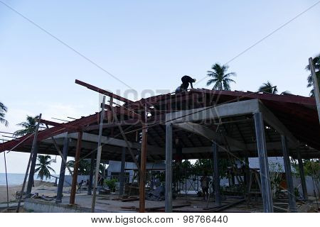 The Worker Is Working On The Roof To Construct The Building