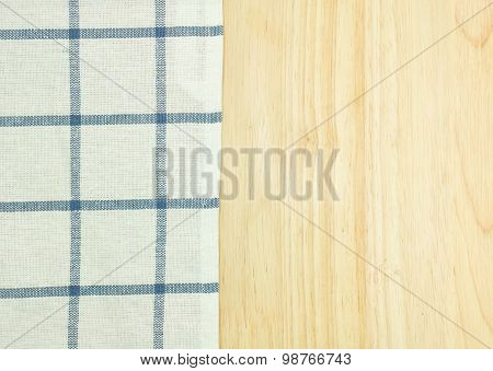Blue tablecloth on wooden table.