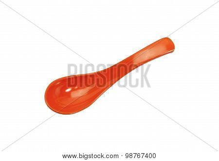 orange plastic spoon isolated on white background.