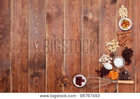 Ingredients Cakes On A Wooden Background.