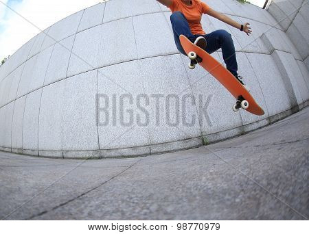 young woman skateboard practice outdoor