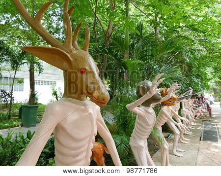 Human Body With Deer And Other Animal Head Statue