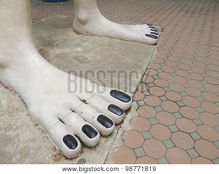 White Foot Statue And Black Nail