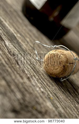 Champagne Cork Lying On A Rustic Wooden Table
