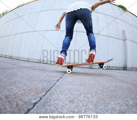 closeup of young woman skateboarder practice outdoor