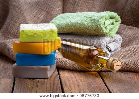 Colorful Handmade Soap Bars With Oil, On Wooden Background