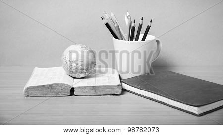 Book And Earth Ball With Color Pencil Black And White Color Tone Style