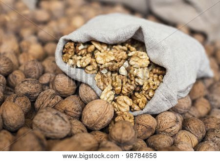 Walnuts Kernels In The Sack On The Pile Of Walnuts