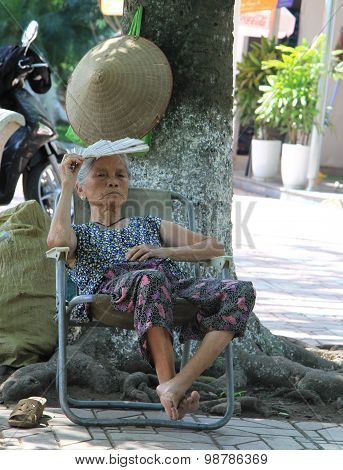 old woman is sitting on the chair, Hanoi