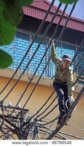 man is trying to repair of electric wires