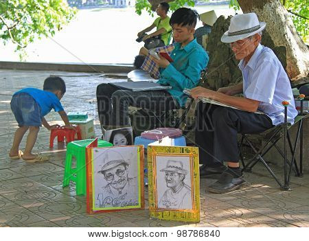 street artist is painting portrait of someone in Hanoi
