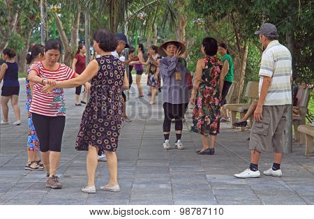 people are dancing in the park of Hanoi