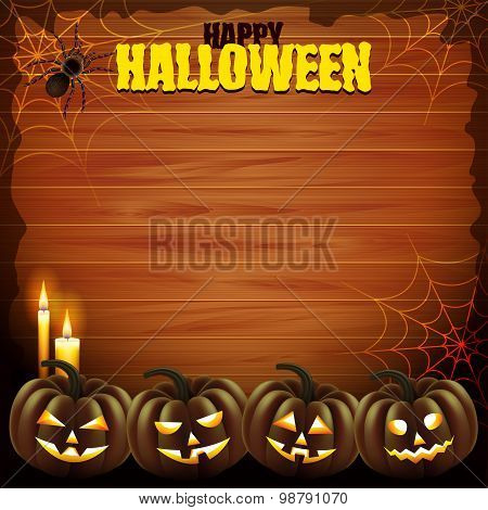 Four Pumpkins On Wood Background Halloween Concept