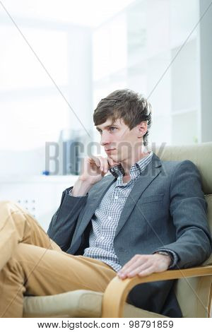 Businessman Sitting In An Armchair