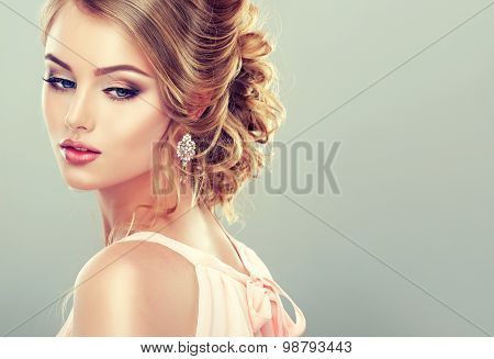 Beautiful model with  elegant hairstyle . Beautiful woman with fashion wedding hairstyle