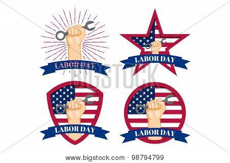 Set of Vector labels of shield with fist punch and fist holding a spanner symbolising workers rights