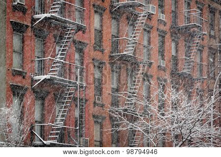 Facade Of Chelsea Brick Building During Snowstorm, New York City