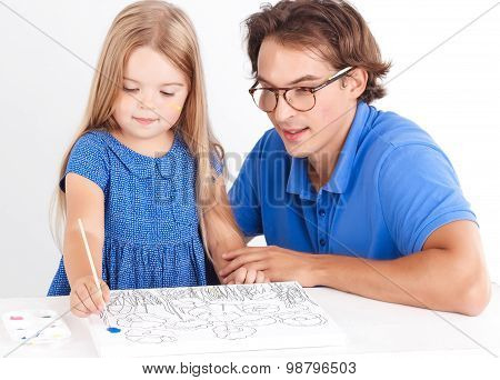 Happy daughter painting with father