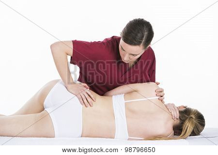 physical therapist gets spinal mobilization