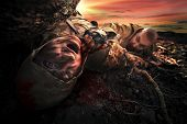 stock photo of cannibalism  - Bloody monster near soldier - JPG