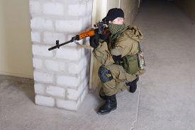 foto of sniper  - mercenary sniper with sniper rifle inside the building - JPG