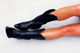 stock photo of cowgirl  - Sexy black cowgirl boots on a cowgirl - JPG
