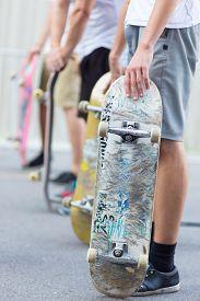 image of skateboard  - Young skateboarders skateboarding on the street - JPG