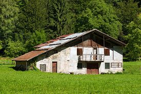stock photo of barn house  - Typical old farm house with barn in mountain - JPG