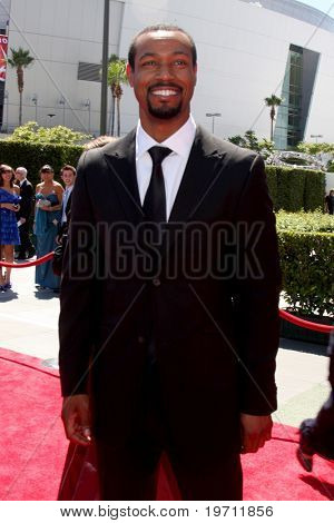 LOS ANGELES - AUG 21:  Isaiah Mustafa  arrives at the 2010 Creative Primetime Emmy Awards at Nokia Theater at LA Live on August 21, 2010 in Los Angeles, CA